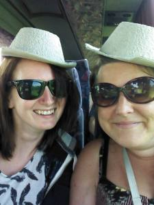 Me and Elly on a school trip, just using the sick bowls as cowboy hats like you're supposed to...